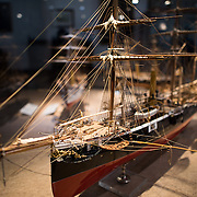 A 1:48 scale model of the corvette Afonso de Albuquerque, a 1110-ton combined propulsion vessel built in 1884. She was the first Portuguese ship built with electric lighting and served mostly in Angola and Mozambique. The Museu de Marinha (Maritime Museum of Navy Museum) focuses on Portuguese maritime history. It features exhibits on Portugal's Age of Discovery, the Portuguese Navy, commercial and recreational shipping, and, in a large annex, barges and seaplanes. Located in the Belem neighborhood of Lisbon, it occupies, in part, one wing of the Jerónimos Monastery. Its entrance is through a chapel that Henry the Navigator had built as the place where departing voyagers took mass before setting sail. The museum has occupied its present space since 1963.