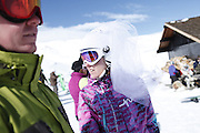 SHOT 2/14/11 12:42:17 PM - Loveland Ski Area in Colorado hosted the 20th Annual Marry Me & Ski Free Mountaintop Matrimony on Valentine's Day Monday, February 14th. The mass wedding ceremony was held at noon at 12,050 feet outside of the Ptarmigan Roost Cabin at Loveland. More than 75 couples were pre-registered to get married or renew their vows high on The Continental Divide in this yearly Loveland tradition.  Following the ceremony couples were invited to a casual reception complete with a champagne toast, wedding cake and music.  (Photo by Marc Piscotty / © 2010)