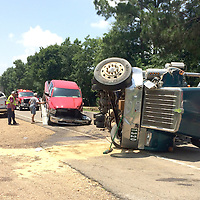 (Floyd Ingram / Buy at photos.chickasawjournal.com)<br /> Wreck crews load up a red Dodge pickup and clean up spilled diesel at a wreck on Highway 8 East shortly after noon Wednesday, June 15, 2016.