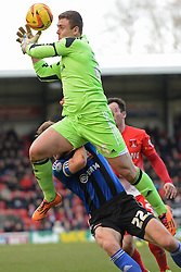 Swindon's Tyrell Belford drops the ball after clashing with Swindon's Darren Ward  - Photo mandatory by-line: Mitchell Gunn/JMP - Tel: Mobile: 07966 386802 22/02/2014 - SPORT - FOOTBALL - Brisbane Road - Leyton - Leyton Orient V Swindon Town - League One