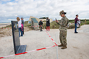 May 30, 2019, Utah Beach,  Normandy, France. A US GI from the Airborn division stands  in front of a commemoration sign during the 75th anniversary of D-Day and Battle of Normandy commemorations. <br /> 30 Mai 2019, Utah Beach, Normandie, France. Un soldat américain de la division Airborn devant une plaque  commémorative  pendant le 75e anniversaire des commémorations du jour J et de la bataille de Normandie.