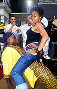 A man and woman dirty dancing in the street, Notting Hill Carnival, 2000's