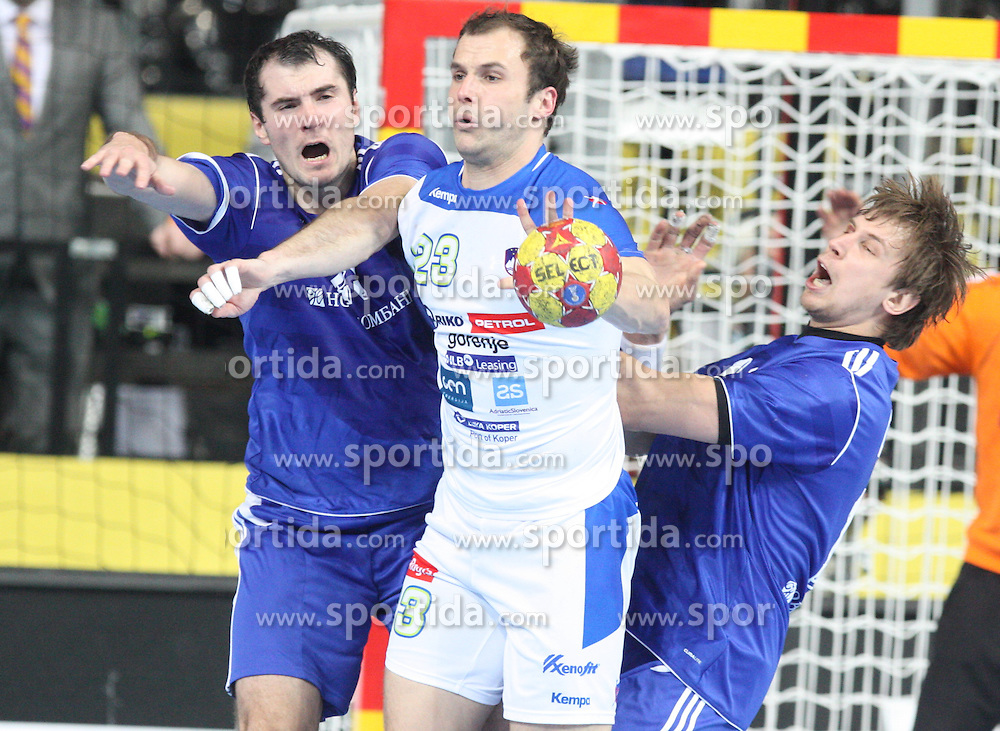 12.01.2013 Barcelona, Spain. IHF men's world championship, Quarter-Final. Picture show Uros Zorman in action during the game between Russia vs Slovenia at Palau ST Jordi