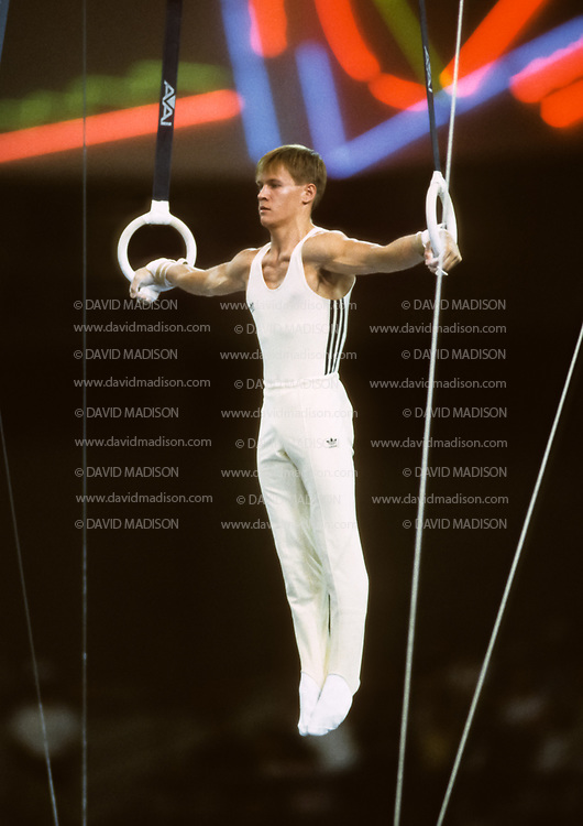 SEATTLE - JULY 1990:  Alexandru Ciuca of Romania performs an Iron Cross on the still rings during the gymnastics competition of the 1990 Goodwill Games held from July 20 - August 5, 1990.  The gymnastics venue was the Tacoma Dome in Tacoma, Washington.  (Photo by David Madison/Getty Images)