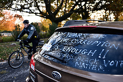 Message on the back of a car parked outside a health care policy event of Republican presidential candidate Donald Trump, Vice-presidential candidate Mike Pence, and former candidate Ben Carson, in King of Prussia, PA, in the Philadelphia Suburbs, on November 1, 2016.