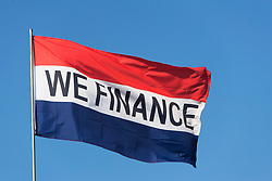 Flag saying We Finance (Credit Image: © Image Source/Alan Schein/Image Source/ZUMAPRESS.com)