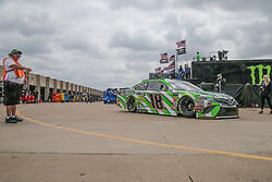 April 6, 2018 - Fort Worth, TX, U.S. - FORT WORTH, TX - APRIL 06: Monster Energy NASCAR Cup Series driver Kyle Busch (18) leaves the garage during practice for the O'Reilly Auto Parts 500 on April 6, 2018 at Texas Motor Speedway in Fort Worth, Texas.  (Photo by George Walker/Icon Sportswire) (Credit Image: © George Walker/Icon SMI via ZUMA Press)