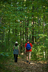Hiking a woodland trail in Pepperell, Massachusetts.