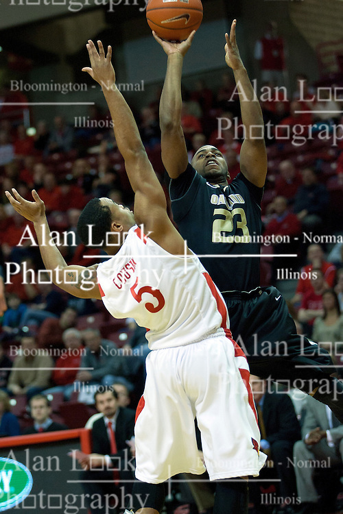 18 February 2012:  Reggie Hamilton goes up hard against defender Anthony Cousin during an ESPN Bracketbuster mens basketball game Where the Oakland Golden Grizzlies lost to the Illinois State Redbirds 79-75 in Redbird Arena, Normal IL