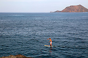 Man board paddling in sea at Corralejo, Fuerteventura, Canary Islands, Spain