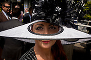 The milliner Liz Felix (www.lizfelixhats.com) wearing one of her own creations during the annual Royal Ascot horseracing festival in Berkshire, England. Royal Ascot is one of Europe's most famous race meetings, and dates back to 1711. Queen Elizabeth and various members of the British Royal Family attend. Held every June, it's one of the main dates on the English sporting calendar and summer social season. Over 300,000 people make the annual visit to Berkshire during Royal Ascot week, making this Europe's best-attended race meeting with over £3m prize money to be won.