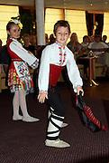 boy & girl wearing colorful traditional costumes doing Bulgarian folk dance; Ruse; Bulgaria