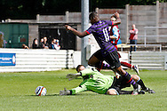 Picture by David Horn/Focus Images Ltd. 07545 970036.04/08/12.Chesham United goalkeeper, Harry Ricketts, cannot stop Nigel Nieta of Arsenal during a friendly match at The Meadow, Chesham.