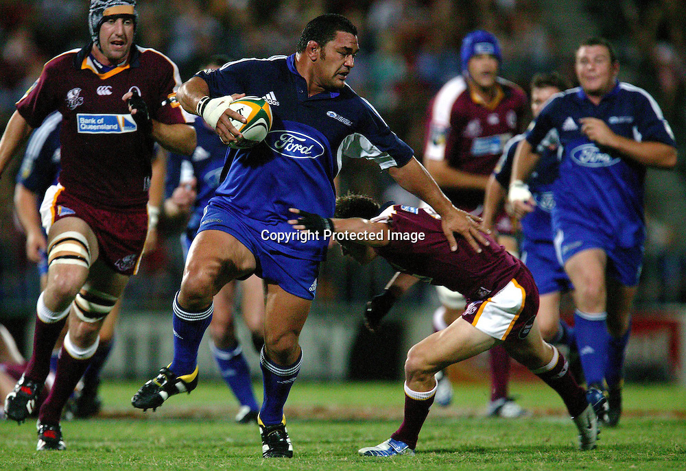13 March, 2004. Ballymore, Brisbane, Australia. Rugby Union Super 12. Auckland Blues v Queensland Reds. Blues forward Kees Meeuws pushes aside the Red's defence. The Blues lost the match, 20 - 3.<br />