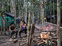 Members of the FARC rebels talk while cooking meat in a camp in the remote Putumayo region of Colombia, on December 9, 2016. (Photo/Scott Dalton)