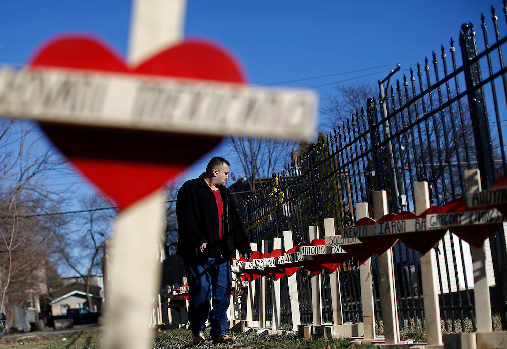 Leroy Vega looks over the wooden crosses at a vigil in honor of all the shooting victims since the start of the year in Chicago, Illinois, February 12, 2017.