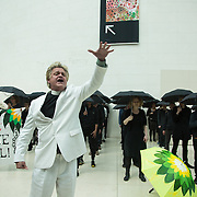 Reverend Billy and the art activist group Bp or not BP call out for the British Museum to stop accepting corporate sponsorship from the oil company BP at the British Museum and to an end to the use of fossil fuels.