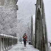Veronika Bojic crosses the Main Street bridge in Cambridge during Saturday's spring snowstorm.<br /> IAN STEWART / SPECIAL TO THE RECORD