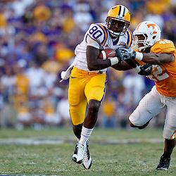 Oct 2, 2010; Baton Rouge, LA, USA; LSU Tigers wide receiver Terrence Toliver (80) runs away from Tennessee Volunteers linebacker LaMarcus Thompson (42) during the second half at Tiger Stadium. LSU defeated Tennessee 16-14.  Mandatory Credit: Derick E. Hingle