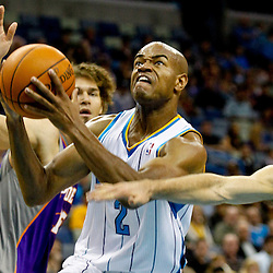 December 30, 2011; New Orleans, LA, USA; New Orleans Hornets point guard Jarrett Jack (2) drives past Phoenix Suns point guard Steve Nash (13) and center Robin Lopez (15) during the first quarter of a game at the New Orleans Arena.   Mandatory Credit: Derick E. Hingle-US PRESSWIRE