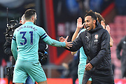 Winning goal hero Pierre-Emerick Aubameyang (14) of Arsenal goes to shake hands with Sead Kolasinac (31) of Arsenal at full time after Arsenal beat Bournemouth 2-1 during the Premier League match between Bournemouth and Arsenal at the Vitality Stadium, Bournemouth, England on 25 November 2018.