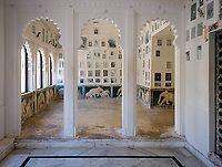 """UDAIPUR, INDIA - CIRCA NOVEMBER 2018: Interior of the City Palace in Udaipur. The city is the historic capital of the kingdom of Mewar. Surrounded by Aravali Range, which separates it from Thar Desert, and full of lakes Udapiur is also known as the """"City of Lakes"""" and dubbed as the most romantic spot of the Indian Continent."""