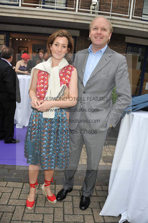 MR ANTHONY & LADY LOUISE BURRELL at a party to celebrate the launch of Bentley's The Collection held at 6 Square Rigger Row, Plantation Wharf, York Road, London SW11 on 25th June 2012.