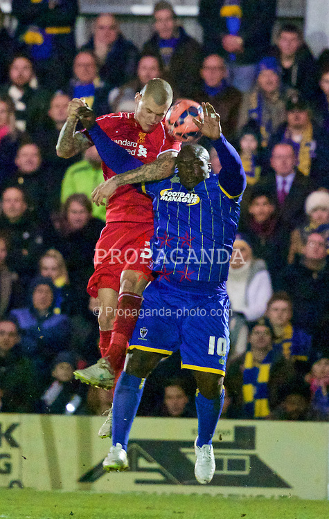 KINGSTON-UPON-THAMES, ENGLAND - Monday, January 5, 2015: Liverpool's Martin Skrtel in action against AFC Wimbledon's Adebayo Akinfenwa during the FA Cup 3rd Round match at the Kingsmeadow Stadium. (Pic by David Rawcliffe/Propaganda)