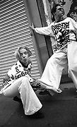 Two clubbers on Oldham street Manchester wearing Joe Bloggs flares and tops, 1988
