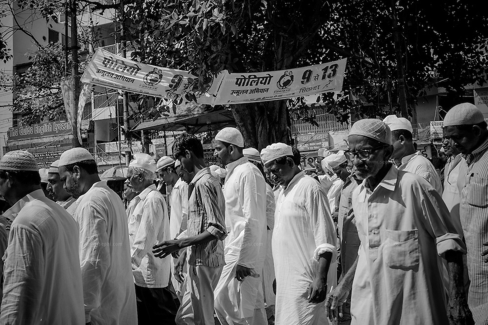 Muslim crowd leaving the mosque after Friday namaz pass by IEC material,  Patna, Bihar