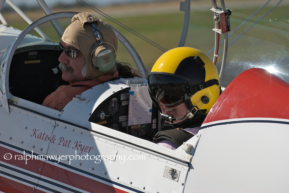 Kate & Pat Kyer in their S-2B acrobatic biplane were one of many participants in the 8th Annual Moonlight Fund airshow in New Braunfels, Texas, October 20, 2007. Co-founded in 1998 by two burn survivors, Henry F. Coffeen III and Celia Jones, the Moonlight Fund is a Texas based organization providing support services for both civilian and military burn victims and their families.