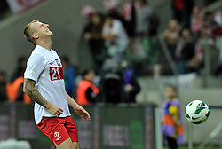 Poland's Kamil Grosicki (nr21) reacts after lost the ball during the 2014 World Cup Qualifying Group H football match between Poland and England at National Stadium in Warsaw on October 17, 2012...Poland, Warsaw, October 17, 2012..Picture also available in RAW (NEF) or TIFF format on special request...For editorial use only. Any commercial or promotional use requires permission...Photo by © Adam Nurkiewicz / Mediasport