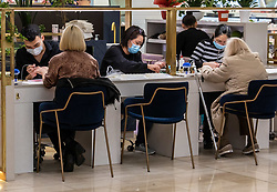 © Licensed to London News Pictures. 05/03/2020. London, UK. Nail bar therapists work in masks at Westfield Shopping Centre, Shepherd's Bush as Prime Minister Boris Johnson appears on This Morning TV show to reassure the public that the Government is doing all it can to fight the coronavirus disease. Photo credit: Alex Lentati/LNP