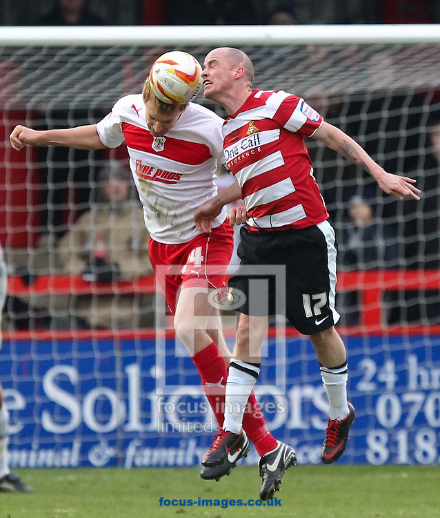 Picture by John  Rainford/Focus Images Ltd +44 7506 538356.12/01/2013.Mark Roberts of Stevenage and Ian Hume of Doncaster Rovers battle for an high ball during the npower League 1 match at the Lamex Stadium, Stevenage.