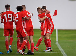WREXHAM, WALES - Wednesday, October 30, 2019: Wales' Christopher Popov (R) celebrates scoring the third goal with team-mate Williams Jenkins-Davies during the 2019 Victory Shield match between Wales and Republic of Ireland at Colliers Park. (Pic by David Rawcliffe/Propaganda)