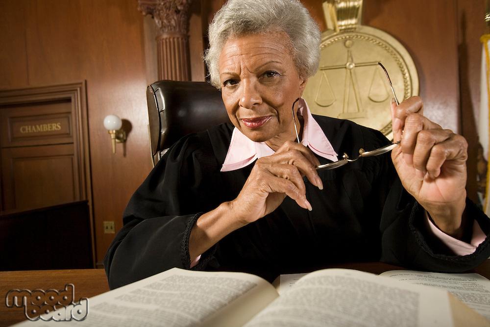 Female judge sitting in court, portrait