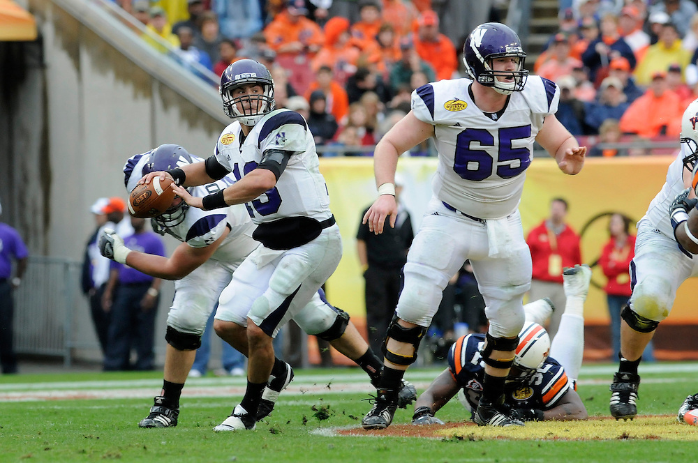 January 1, 2010: Mike Kafka (13) and Ben Burkett (65) of the Northwestern Wildcats in action during the NCAA football game between the Northwestern Wildcats and the Auburn Tigers in the Outback Bowl. The Tigers defeated the Wildcats 38-35 in overtime.