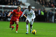 Swansea city's Nathan Dyer goes past ex teammate Joe Allen. Barclays Premier league, Swansea city v Liverpool at the Liberty Stadium in Swansea , South Wales on Sunday 25th November 2012. pic by Andrew Orchard, Andrew Orchard sports photography,