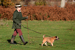 UK ENGLAND SURREY TILFORD 13NOV04 - Hunting veteran Prudence Goodchild walks across rural country during a foxhunt in rural Surrey with the Surrey Hunters Union, founded in 1798. She remembers her first hunt which took place in 1937.....jre/Photo by Jiri Rezac ....© Jiri Rezac 2004....Contact: +44 (0) 7050 110 417..Mobile:  +44 (0) 7801 337 683..Office:  +44 (0) 20 8968 9635....Email:   jiri@jirirezac.com..Web:    www.jirirezac.com....© All images Jiri Rezac 2004 - All rights reserved.