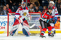 KELOWNA, BC - NOVEMBER 26:  Leif Mattson #28 of the Kelowna Rockets looks for the rebound as Sebastian Cossa #33 of the Edmonton Oil Kings defends the net during first period at Prospera Place on November 26, 2019 in Kelowna, Canada. (Photo by Marissa Baecker/Shoot the Breeze)