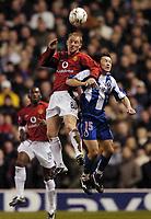 Photo. Jed Wee.<br /> Manchester United v FC Porto, UEFA Champions League, Old Trafford, Manchester. 09/03/2004.<br /> Manchester United's Nicky Butt (L) wins a header against Porto's Dmitri Alenitchev.
