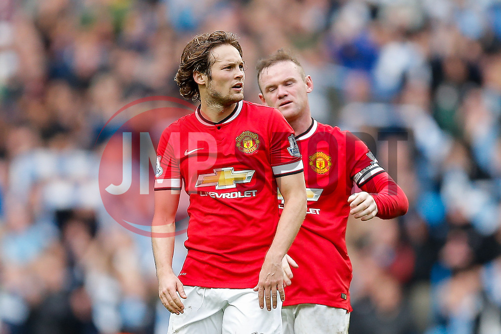 Daley Blind and Wayne Rooney of Manchester United look dejected after Manchester City win the game 1-0 - Photo mandatory by-line: Rogan Thomson/JMP - 07966 386802 - 02/11/2014 - SPORT - FOOTBALL - Manchester, England - Etihad Stadium - Manchester City v Manchester United - Barclays Premier League.