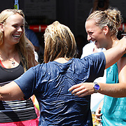 Tournament Director Anne Worcester (centre), takes the ALS Ice Bucket Challenge with the help of Tennis players Simona Halep, (not in frame), Caroline Wozniack, (left), and Petra Kvitova, (right), during the Connecticut Open at the Connecticut Tennis Center at Yale, New Haven, Connecticut, USA. 17th August 2014. Photo Tim Clayton