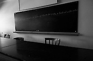 """Blackboard in a classroom. Childhood must not be a period of crisis. In Portugal , as in generally the  """"occidental world"""", the public debt extends to future generations, forming a depressing future where insecurity reigns. The austerity policies affect human evolution in its most basic principles. What is the future? Children are the future, the hope for a better world depends on education in its broadest sense. Money from taxes are not invested in education or health, are used to support the debt and the banking system. In this project I focused on a fragment of a more general work about the crisis, alluding childhood and its consequences in the current socio-economic context."""