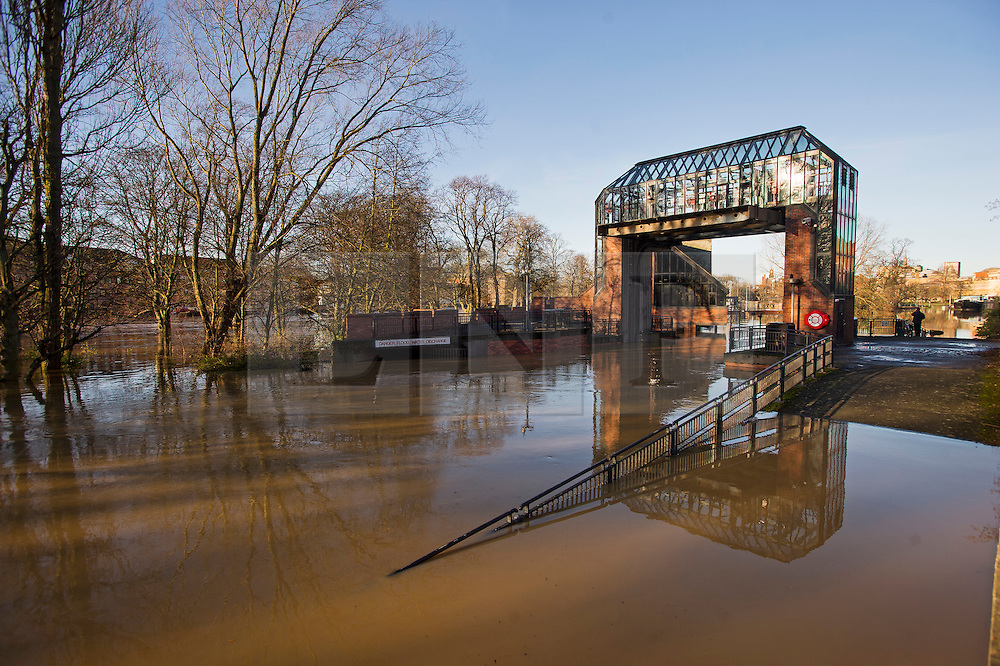 © Licensed to London News Pictures. 27/12/2015. York, UK.  The Foss barrier in York sitting open. Thousands of homes in York have flooded after the flood barrier protecting the city was lifted last. The Environment Agency said water had entered the Foss Barrier's building, putting pumps in danger of failing due to electrical problems.  Large areas of the North of England have been hit by severe flooding following unusually heavy rainfall in December. Photo credit: Ben Cawthra/LNP