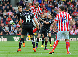 Stoke City's Steven N'Zonzi and Liverpool's Lucas Leiva battle for the high ball- Photo mandatory by-line: Nizaam Jones/JMP - Mobile: 07966 386802 - 24/05/2015 - SPORT - Football - Stoke - Britannia Stadium - Stoke City v Liverpool - Barclays Premier League