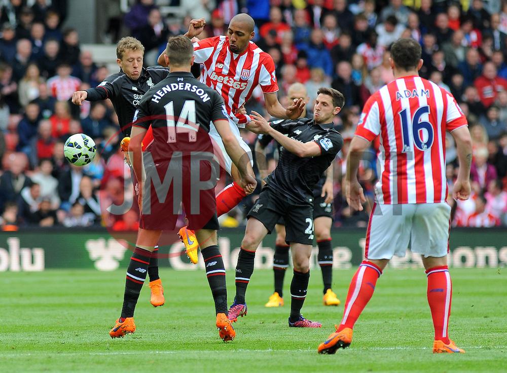 Stoke City's Steven N'Zonzi and Liverpool's Lucas Leiva battle for the high ball- Photo mandatory by-line: Nizaam Jones/JMP - Mobile: 07966 386802 - 24/05/2015 - SPORT - Football - Stoke - Britannia Stadium - Stoke City v Liverpool - Barclays Premier League