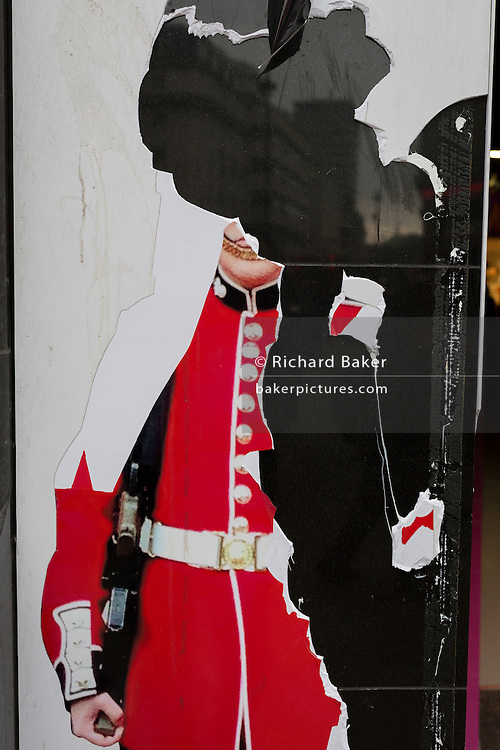 Detail of a torn image of a guardsman, on 15th February 2017, in London, United Kingdom.