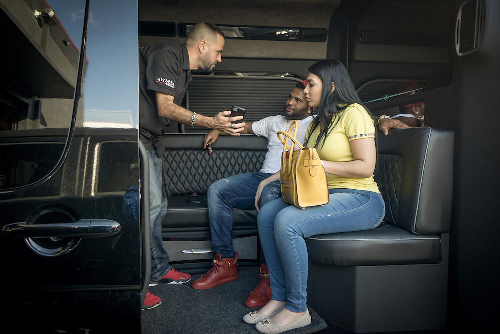 DORAL, FLORIDA, DECEMBER 11, 2015<br /> Alex Vega, left, owner of The Auto Firm, a South Florida car customizing and restoring shop which has a vast clientele of professional athletes and entertainers,  shows Pablo Sandoval and wife Yulimar Martins a customized Mercedes Benz limo van. The van sells for $175.000.<br /> (Photo by Angel Valentin/Freelance)