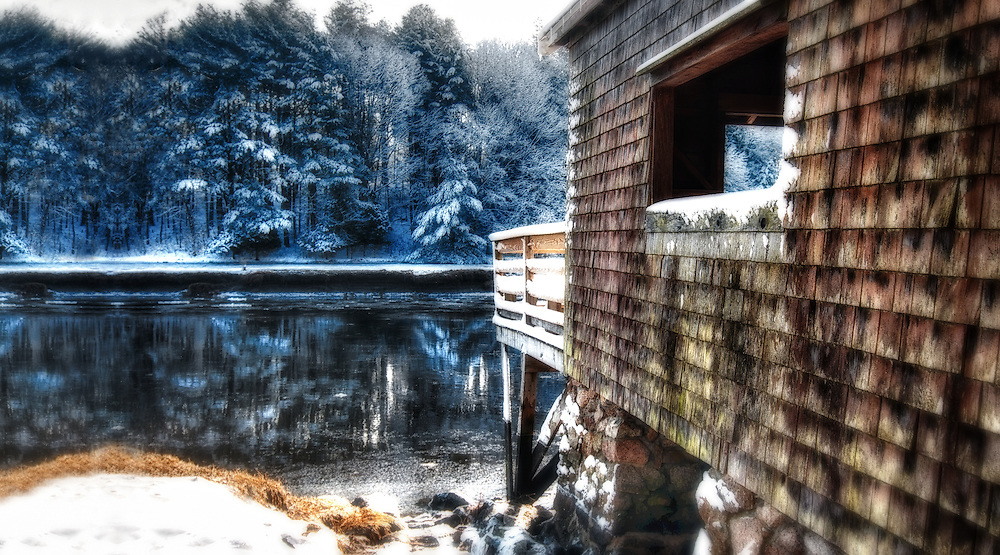 Winter along the North River and boathouse in the Norris Reservation in Norwell, Massachusetts